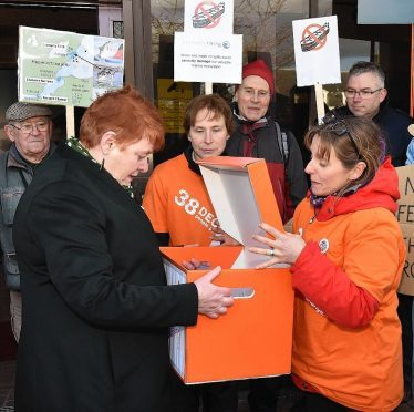 Council leader Margaret Davidson receives the symbolic petition from campaigner Joanne Paterson.