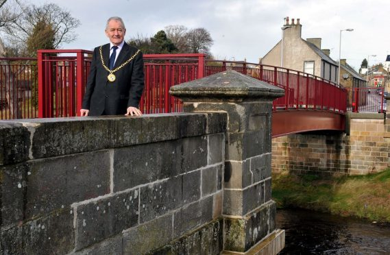 Moray Council convener Allan Wright at one of the footbridges built as part of the defences.