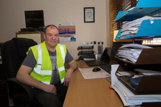 Gavin Sinclair of Norbloc Construction Ltd in his Halkirk office.