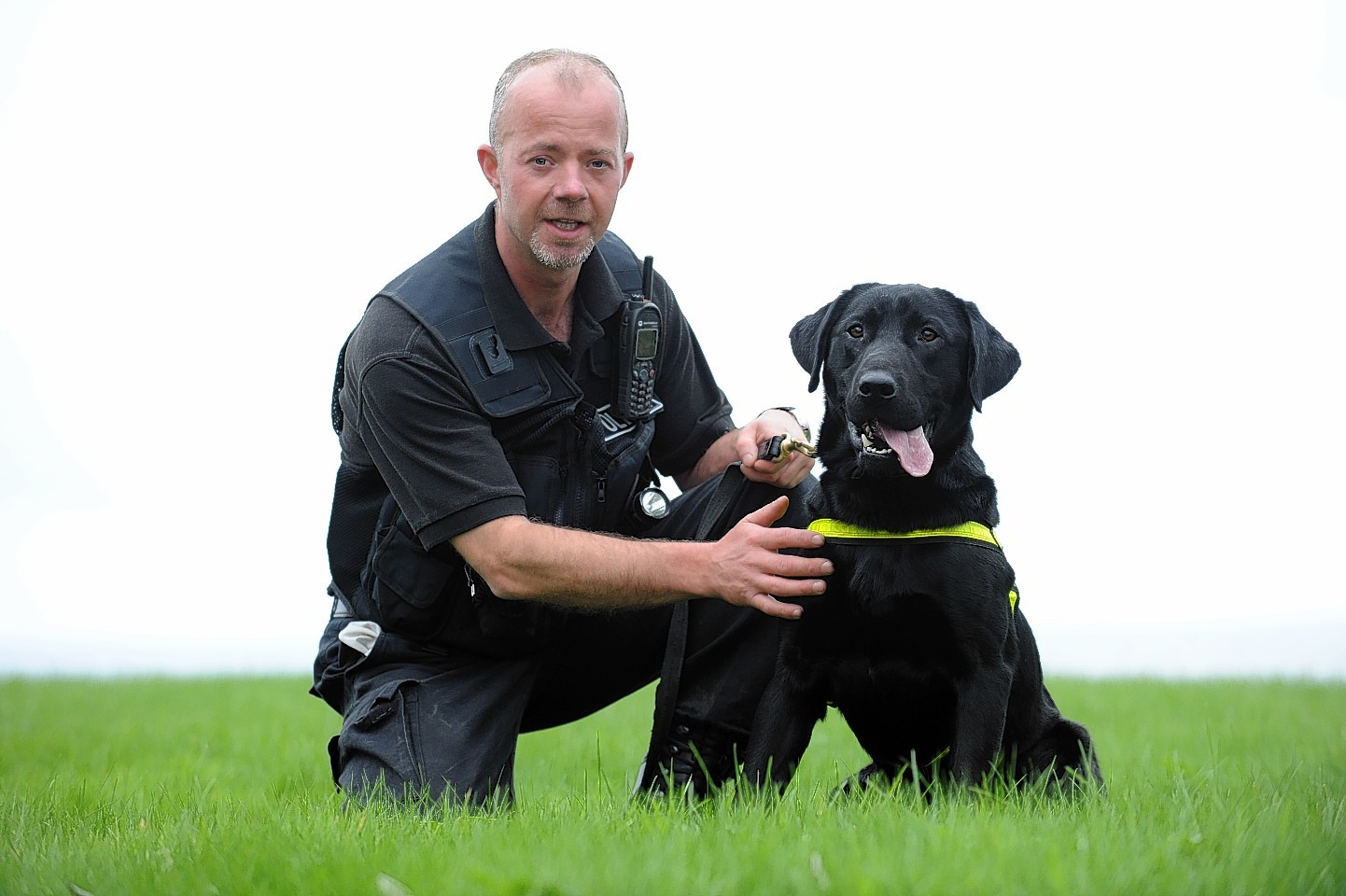 George Shearer with police dog Sam