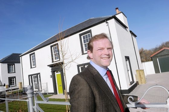Lord John Moray photographed with some of the completed homes. Picture by Sandy McCook