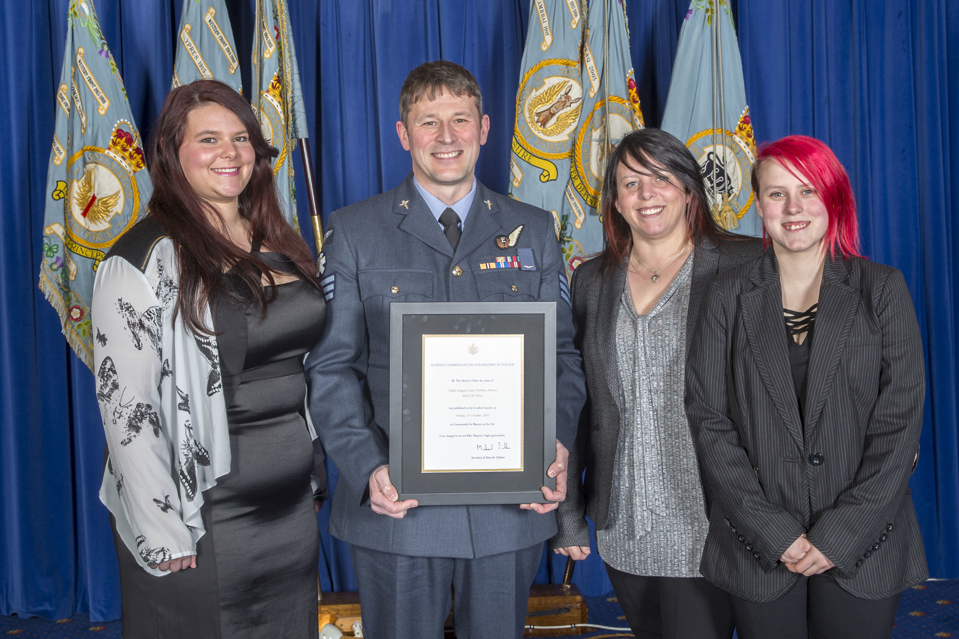 Sgt Proctor, who lives in Forres with his wife Elizabeth and daughters Shannon, pictured far left, and Caitlyn, far right, after being presented with the bravery award.