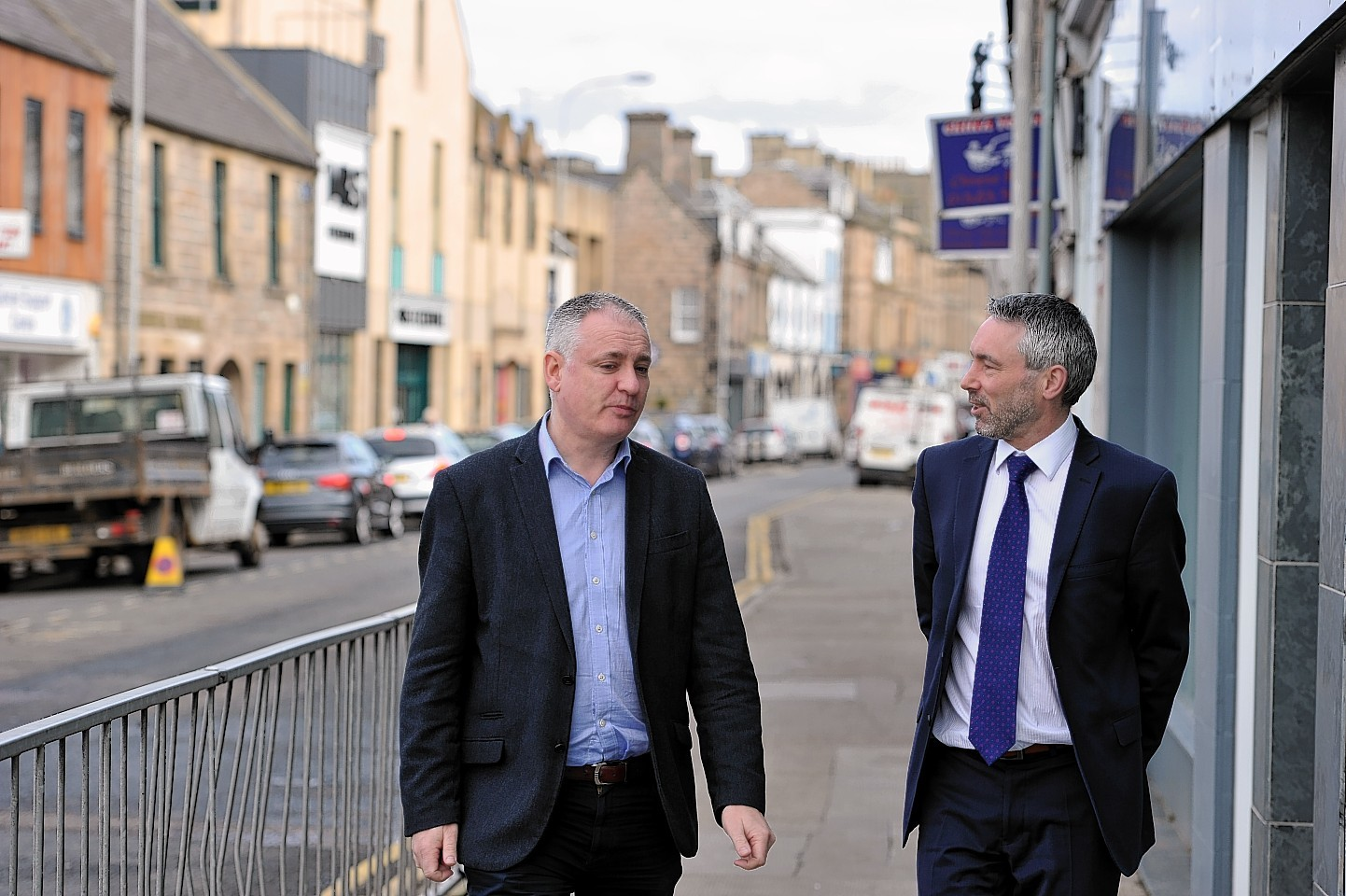 MSP Richard Lochhead, left, with independent rates assessor, Ian Milton, right, in High Street, Elgin, following a fact-finding meeting between them.