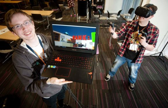 Alan Yeats, left, and Gary McCartan used virtual reality to create the best video game at Moray Game Jam.