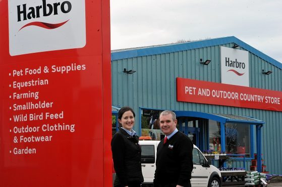 Elizabeth Patterson and John Allison at the newly re-branded store in Elgin.