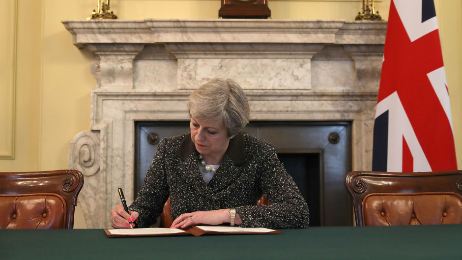Prime Minister Theresa May in the cabinet signs the Article 50 letter, as she prepares to trigger the start of the UK's formal withdrawal from the EU on Wednesday.