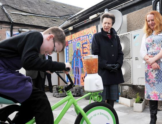 Connor Mcnulty, 12, demonstrates the pedal-powered smoothie maker for the Princess Royal.