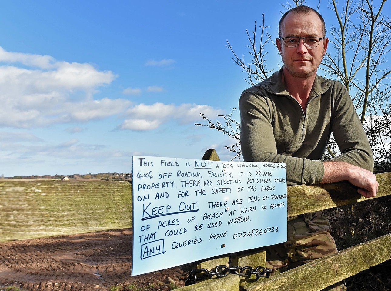 Auldearn farmer Craig Philip and his sign.