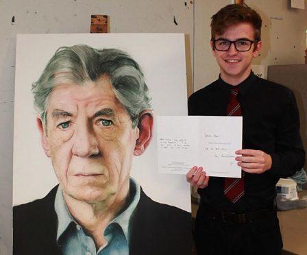 Steven Rae with his portrait of Sir Ian McKellen