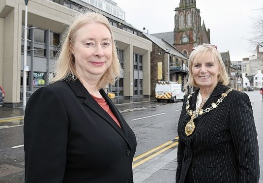 Brenda Pound of Wipro and City Provost Helen Carmichael outside the company's new Inverness offices.