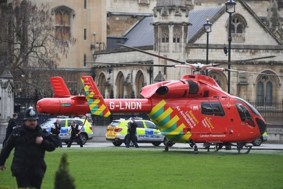 An Air Ambulance outside the Palace of Westminster, London, after sounds similar to gunfire have been heard close to the Palace of Westminster. A man with a knife has been seen within the confines of the Palace, eyewitnesses said
