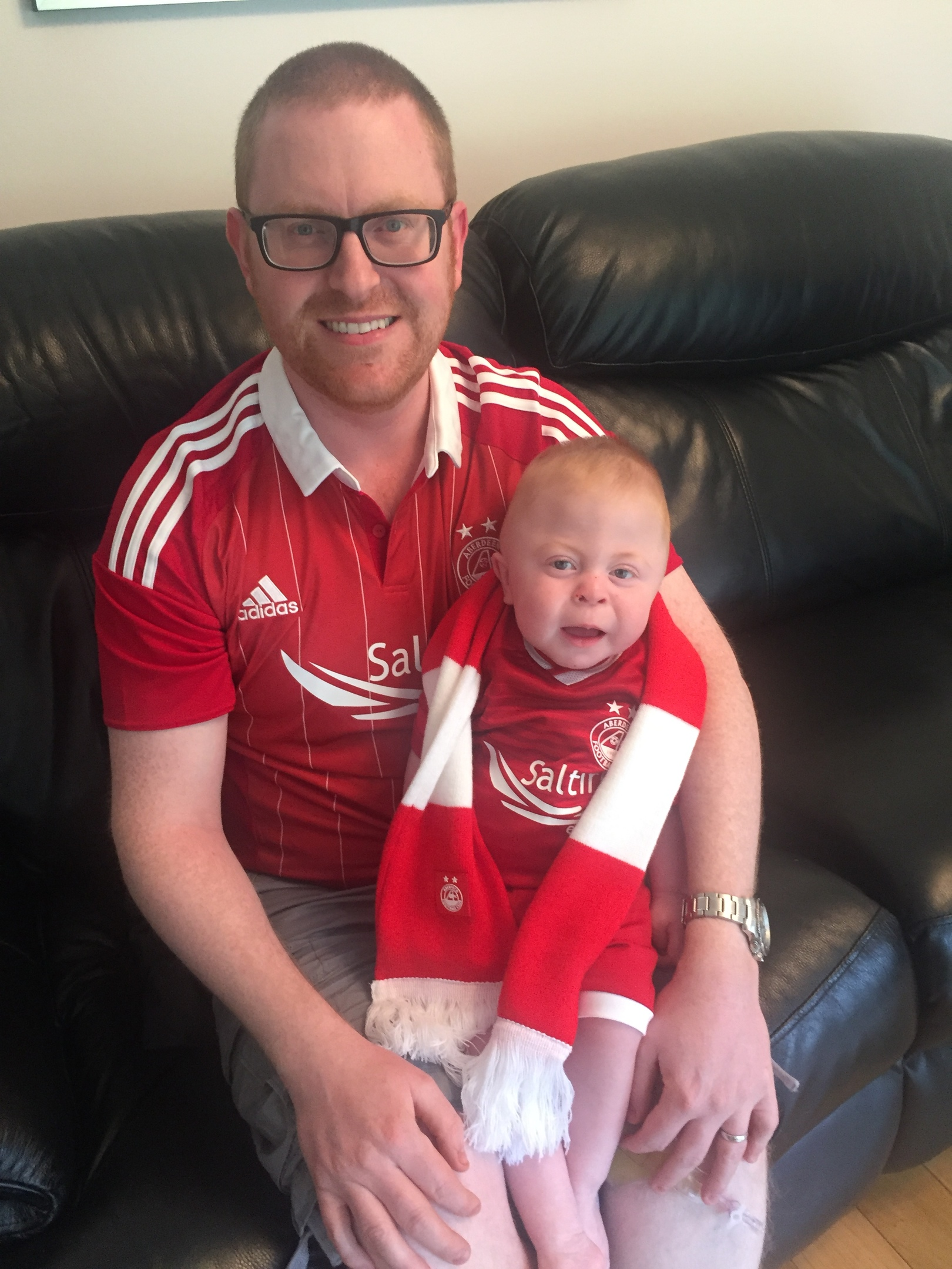 Accountant Bruce Edmond, who is pictured with son Jack, is appealing for help to find his signed Gothenburg top.