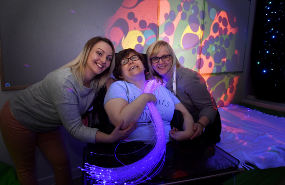 A new multi-million day centre for adults with learning and physical disabilities which will replace the outdated Rosehilll Day Centre, was opened at Mastrick. Centre user Gemma Cook enjoys the sensory room with support workers Elaine Clark (left) and Tracey Duncan.