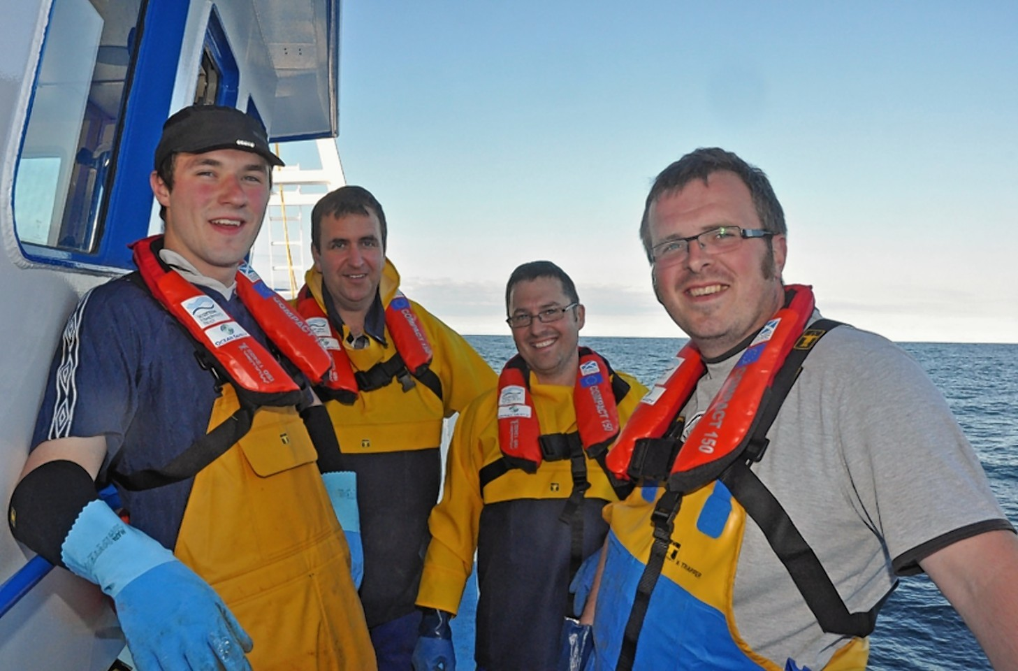 Members of the crew of the Shetland whitefish boat Guardian Angell wearing their PFDs