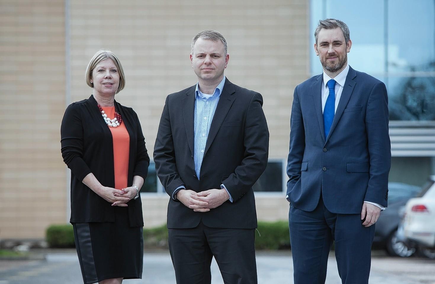 Loganair MD Jonathan Hinkles (centre). Commercial director Kay Ryan Finance director David Dishon