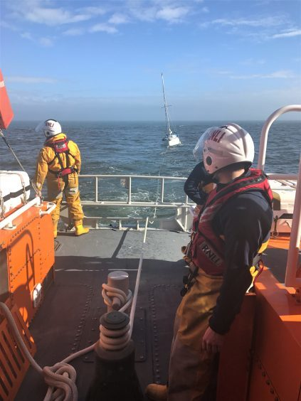 Crew on board the Aberdeen lifeboat tow the stricken Fleur back to Aberdeen harbour