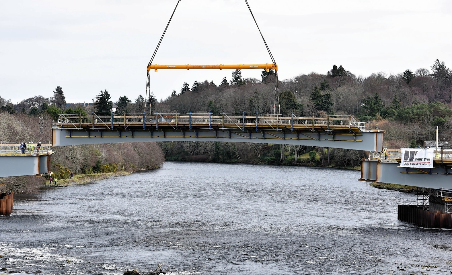 The bridge beams being lifted into place back in March