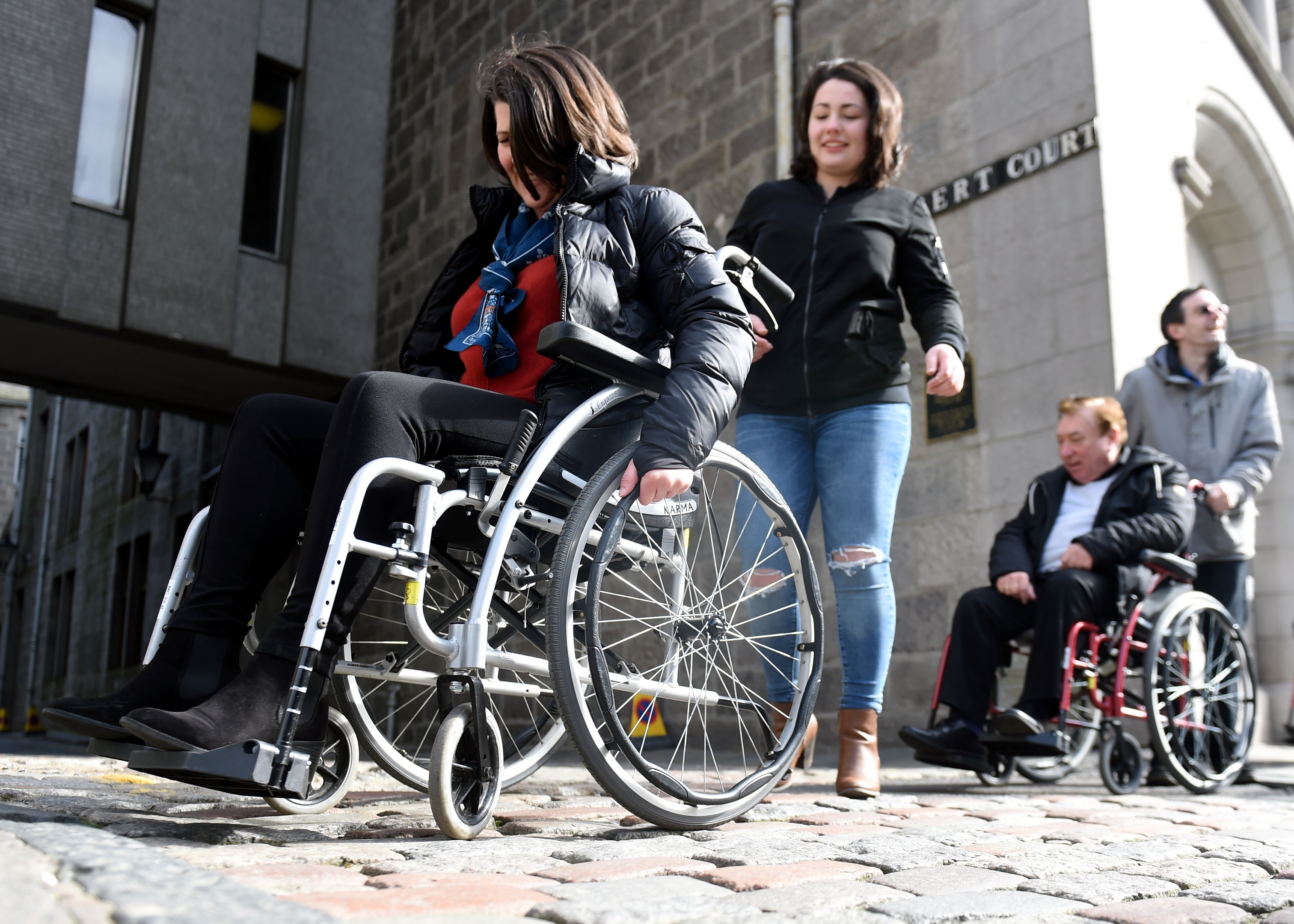 Future Choices challenged Aberdeen City Councillors to travel from Union Square shopping centre to Aberdeen Town House in a wheelchair. Pictured are Councillor Marie Boulton and Councillor Len Ironside on Broad Street.