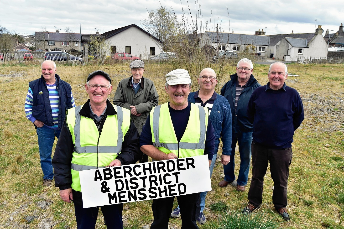 In 2017 CELEBRATING AT ABERCHIRDER  ON THE GROUND THEY HAVE SECURED TO BUILD THEIR MENS SHED ARE (WITH SIGN) KENNY CHRISTIE, CHAIRMAN AND DOD CHRISTIE VICE CHAIRMAN.LOOKING ON ARE (L TO R) BILL LEGGE, ALEXANDER SYMON, JIM PATERSON, DAVID CHALMERS AND MIKE O'BRIEN.