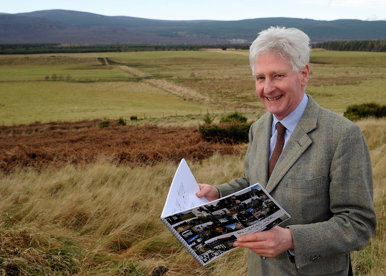 John Grant of Rothiemurchus Estate with the site of the proposed An Camus Mor development at the rear in the far distance.