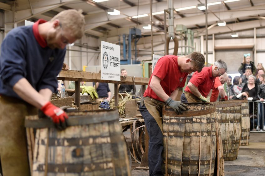 (L-R) Callum Lawson, Kyle Cooper, David McKenzie and Brent Bowie race through the construction of the whisky barrel.