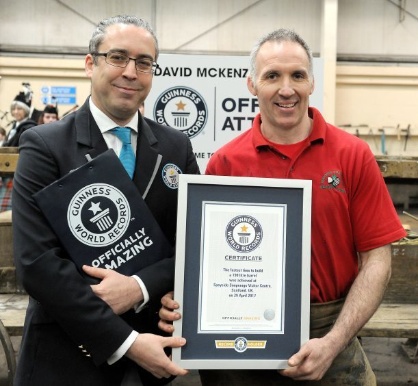 David with Jack Brockbank , the official adjudicator from Guinness World Records.