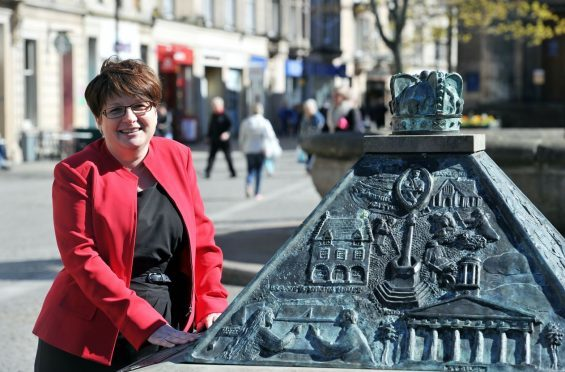 Gill Neill, manager of Elgin Bid, is positive about the town centre's future.