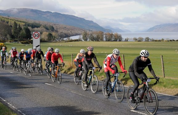 Cyclists pass through Dores on the 2016 Etape Loch Ness