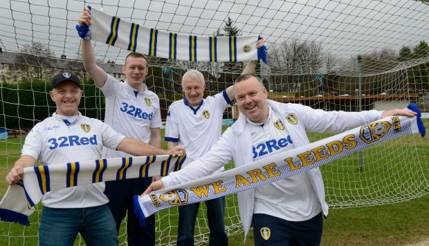 Peter (left) and Martin (right) MacDonald with Bradley (second left) and John Flannigan who attend each Leeds home game