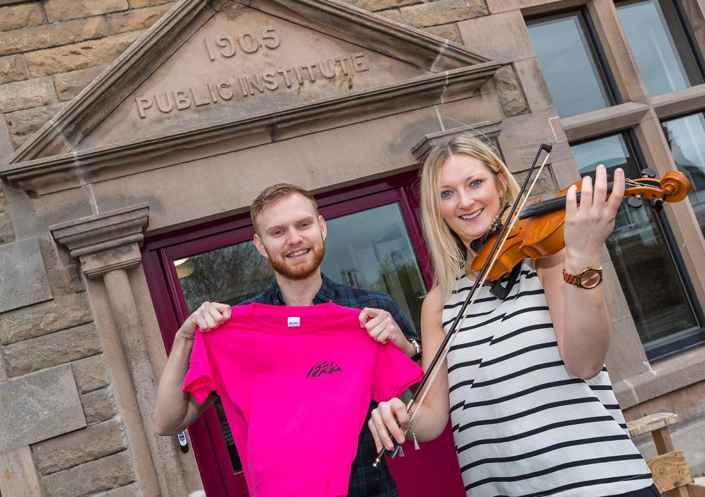 Fiddle instructors Jack Smedley and Mhairi Marwick outside the refurbished Fochabers Institute.