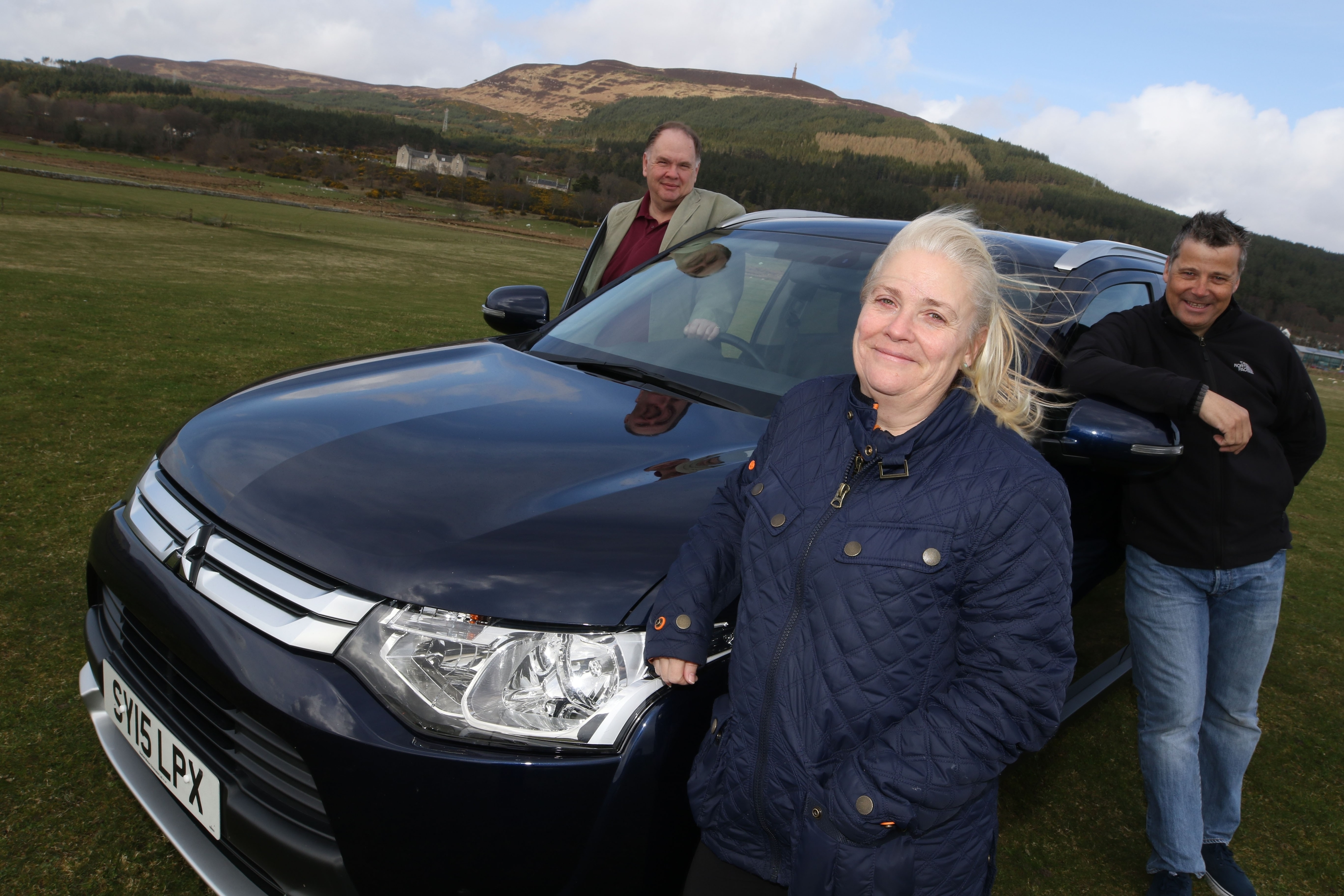 Pictured are Andy Cooper (Go Golspie board member), Tracey Campbell (event organiser) and John Murray (chairman of Go Golspie), with one of the 4x4s that will make the trip