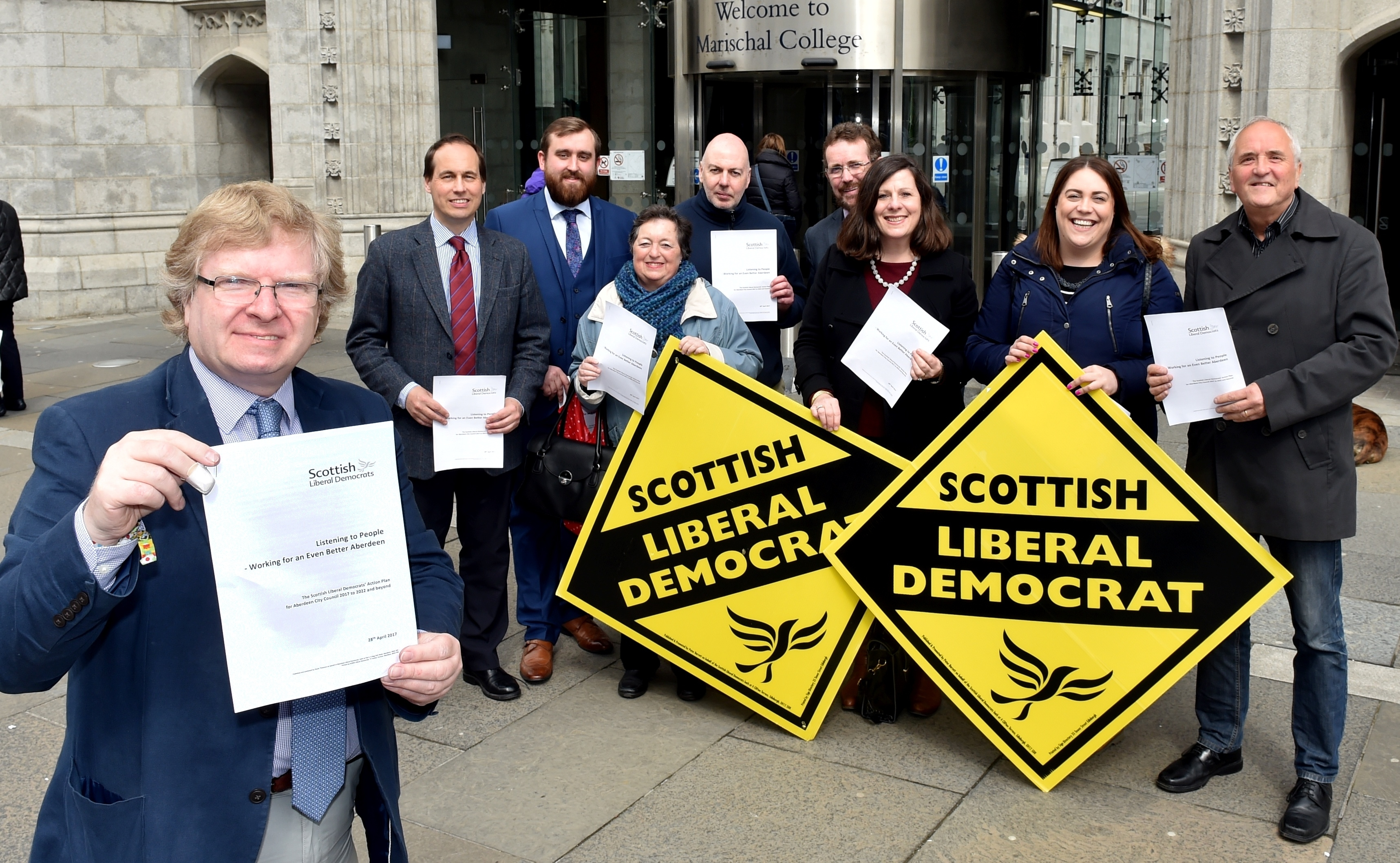 The Liberal Democrats held their manifesto launch outside Marischal College in Aberdeen. Leader Iain Yuill with (from left) Martin Greig, Cameron Finnie, Dorothy Pearce, Gregor McAbery, Steve Delanay, Jennifer Stewart, Jenny Wilson and Ken McLeod. Picture by Colin Rennie.