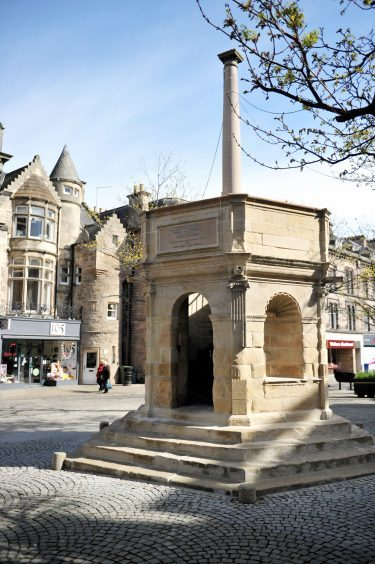 Elgin's Muckle Cross in the High Street is unveiled after refurbishment.