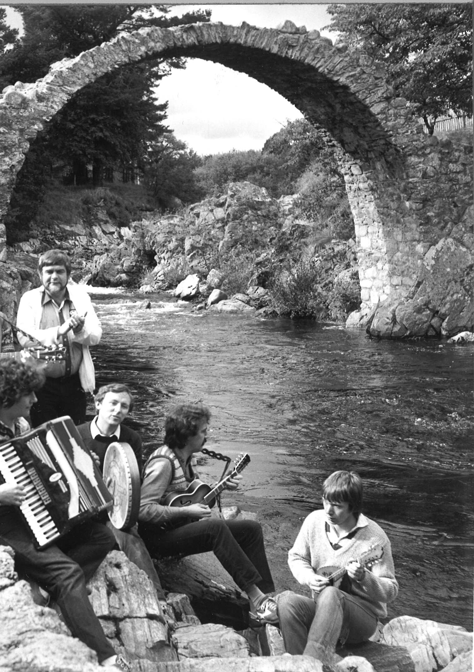 Musicians enjoying some playing by the water at Carrbridge Ceilidh Week, 1983