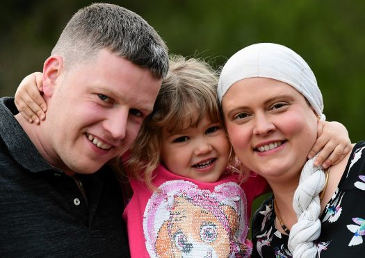 Naomi is pictured with her husband Neil and daughter Layla. Picture by Kami Thomson