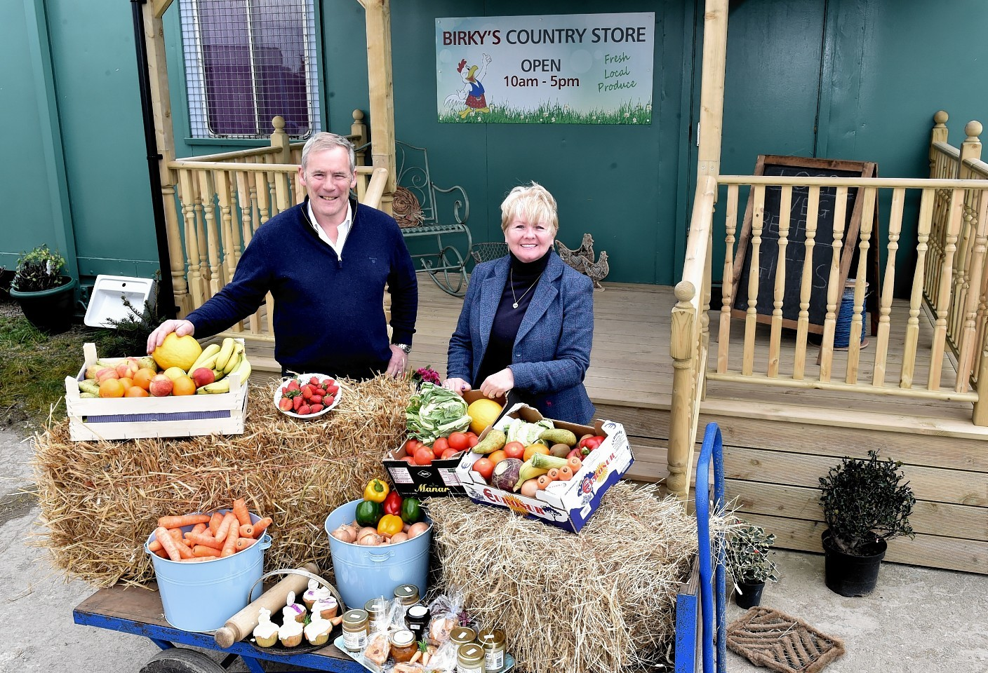 Norman and Robina Fiddes outside the farm shop