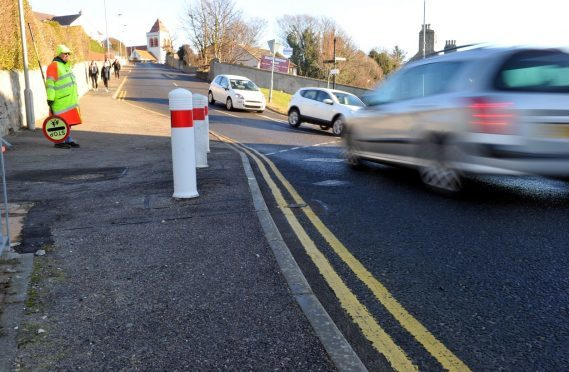 Campaigners want improvements to the junction at School Brae in Lossiemouth.