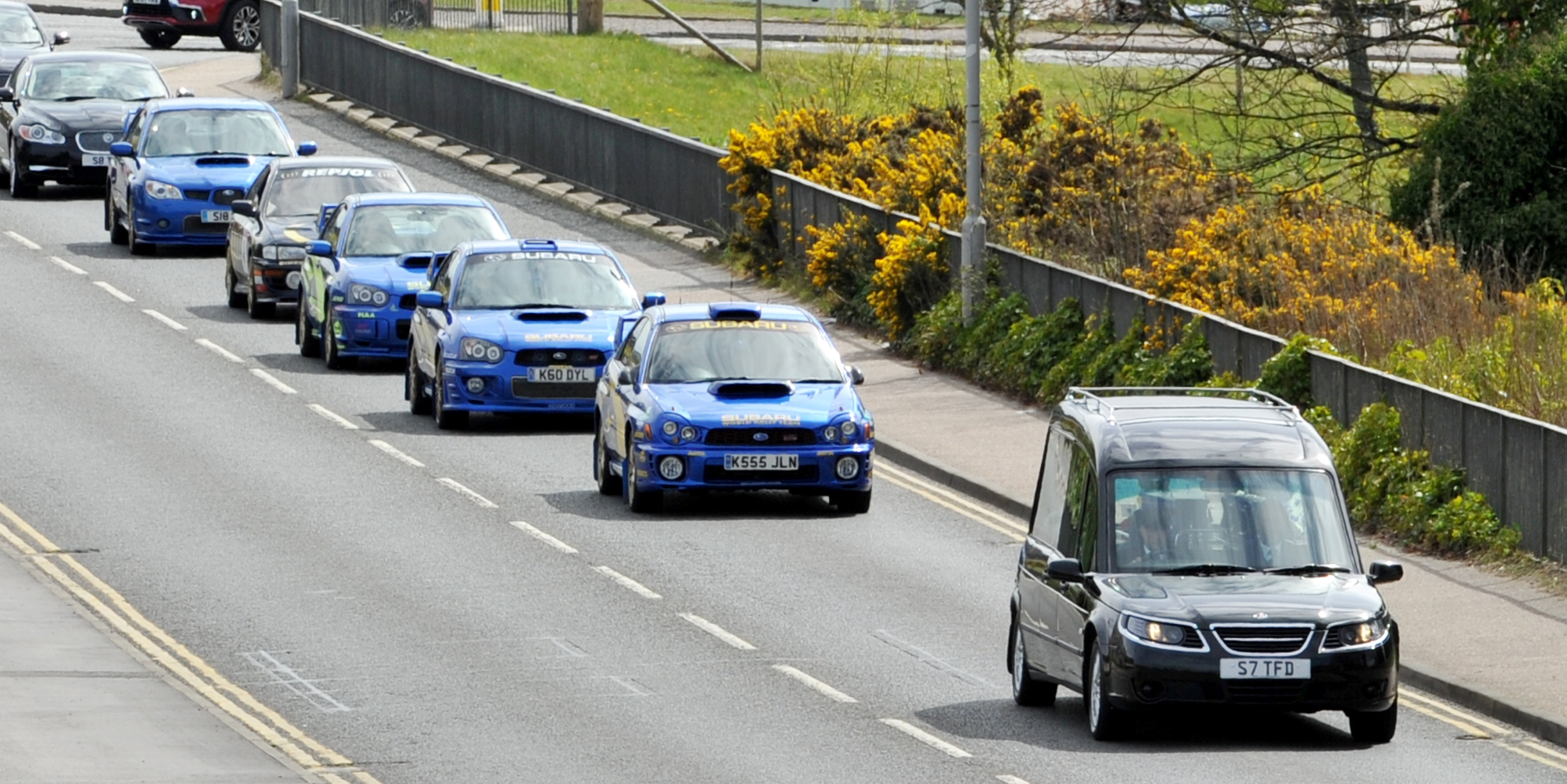 Funeral cortege for Kieran McQuillan, led by hearse and Subaru cars from Elgin Town Hall to Lossiemouth cemetery.