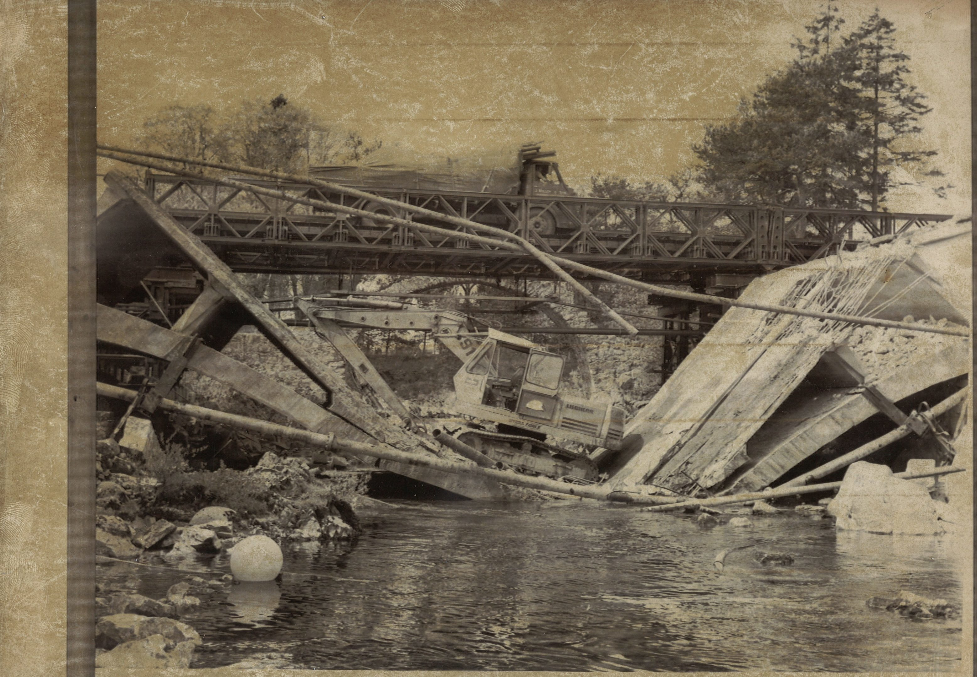 The old road bridge collapsed with hydraulic excavator in 1974