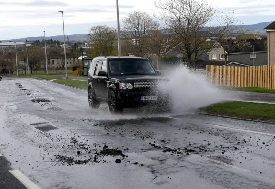 Burst watermains and damage to the road on Westhill Drive.