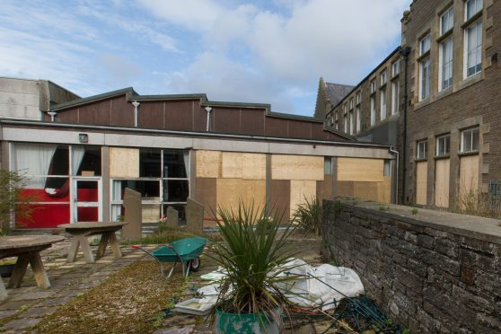 Some of the large windows at the side of the school hall were among the 30 broken at Wick High School.