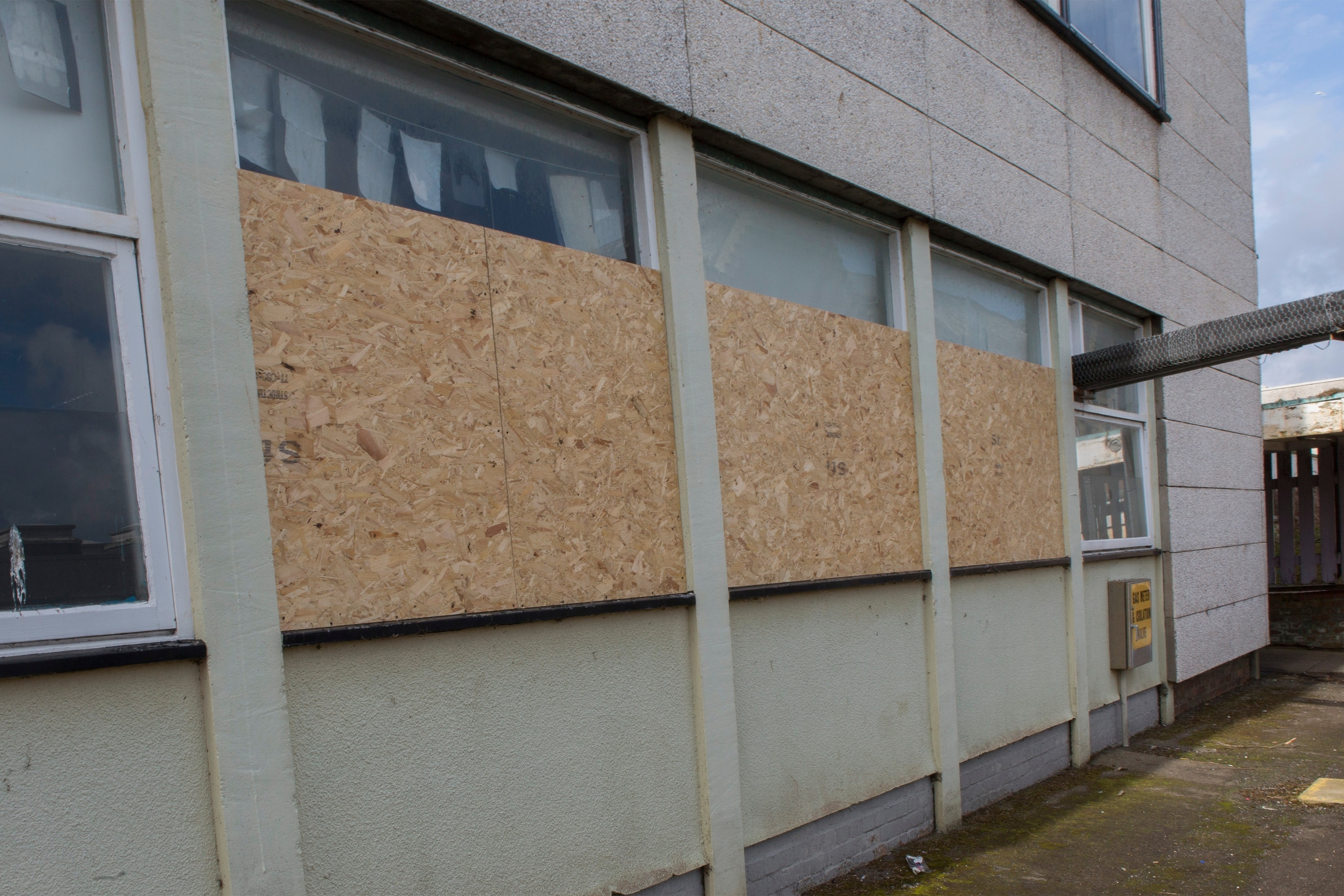 Boarded up windows in one of the blocks at the rear of Wick High School.