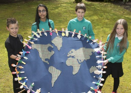 28/04/17 L-R Gregor Morison (10YO pr6),Hayfa Sheik (12YO pr7), Finlay Clubb (11YO pr7),Aaliyah Craig (11YO pr7)  The Global Group at Hazlehead School unveils its Global Goal sculpture trail at Hazlehead Park today. The school project aims to educate the community about the Global Goals as decided by the United Nations.  The sculpture trail, designed by and built by all the Primary School pupils, has 17 sculptures representing each of the 17 Global Goals.  All primary children have contributed to the sculptures.