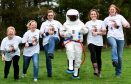 Team AJ meet Steve the spaceman as they prepare for the Moontrose Night Walk