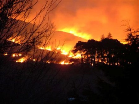 Wildfires have occurred in the west of Scotland while the rest of the country is battling heavy snow.