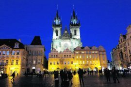 People gather in Prague's Old Town Square to admire the twin spires of Tyn Church. Some say it inspired Walt Disney's design for Sleeping Beauty's castle. Copyright Amy Laughinghouse.