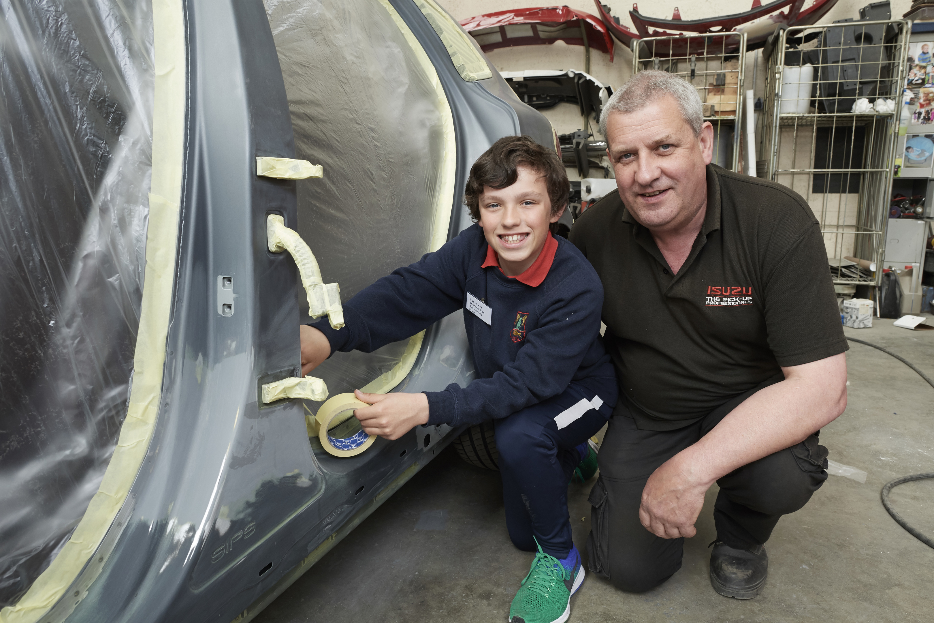 Rhuairidh MacDonald with his dad Philip MacDonald at the Donald Mackenzie car body shop.