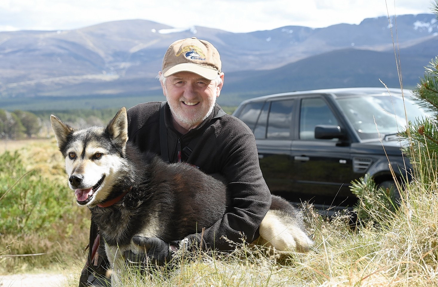 Alan Stewart of Rothiemnurchus with one of his Alaskan Huskies. Pic by Sandy McCook