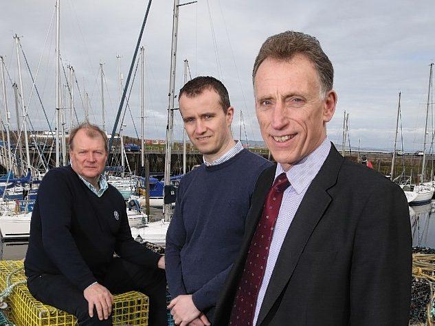 Nairn business leaders Michael Green and Michael Boylan welcome Alan Rankin.