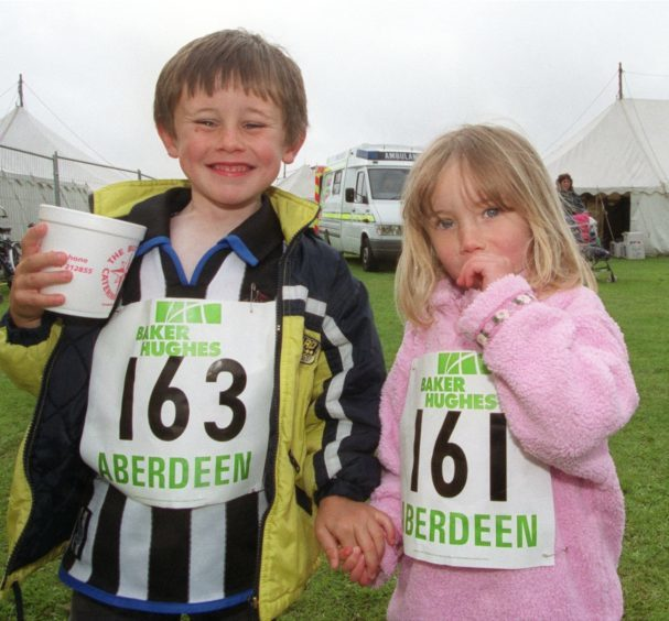 Runners Gavin5, and Ellen,3, Thomas of Danestone, after the 1K fun run event in 2000